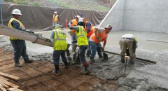 Urban Corps pouring cement