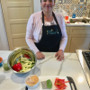 Jacqueline Ante, a kitchenista from National City, prepares fresh vegetables