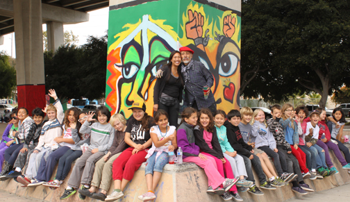Explorer Charter Elementary school pictured with their teacher Ms Mari Jones and muralist Mario Torero.Photo by June Bayha