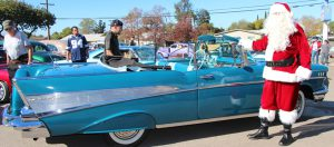 No respectable Santa would arrive at a Lowrider Toy Drive in anything less than a Chevy. This year Santa was Rob Rice from Majestics Car Club.