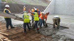 Urban Corps members pouring cement for the handball court.